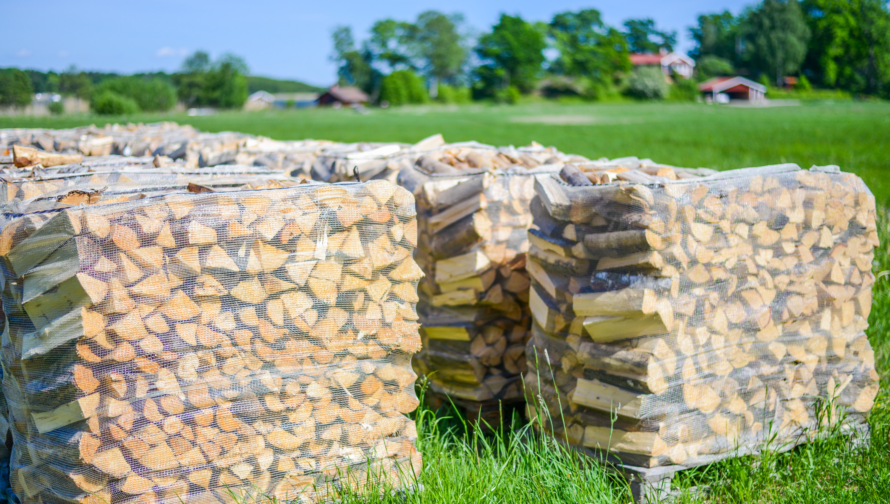 Overview of piles of firewood for sale
